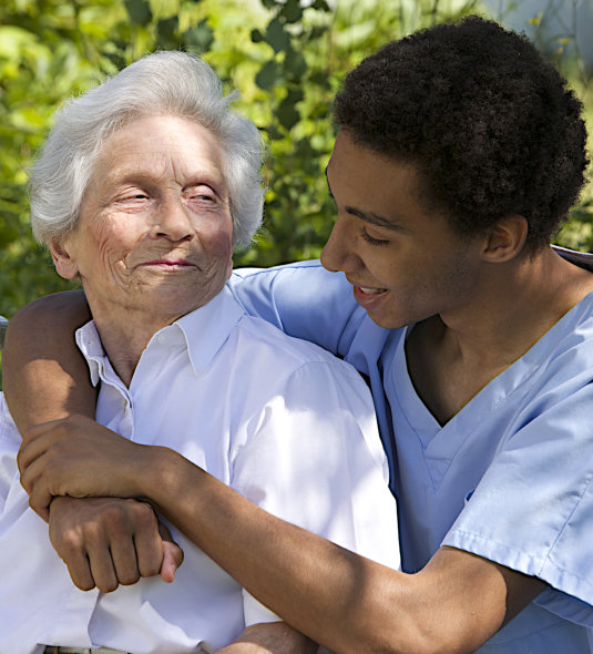 caregiver talking to an elder
